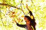 Женщина подбрасывает листья в осеннем парке, фото № 2859985, снято 6 октября 2010 г. (c) Иван Михайлов / Фотобанк Лори