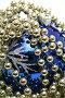 Синий стеклянный шар и праздничные бусы на белом фоне, фото № 14117, снято 20 ноября 2006 г. (c) Александр Паррус / Фотобанк Лори