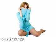 Купить «Красивая девушка, прикрывающая лицо рукавом голубой рубашки», фото № 29129, снято 24 марта 2007 г. (c) Вадим Пономаренко / Фотобанк Лори