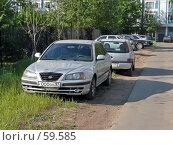 Купить «Автомобили на газоне», фото № 59585, снято 15 июля 2018 г. (c) ДЕНЩИКОВ Александр Витальевич / Фотобанк Лори