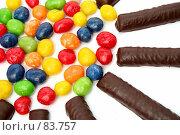 Купить «Шоколадные палочки и конфеты в разноцветной глазури, на белом фоне», фото № 83757, снято 9 января 2007 г. (c) Александр Паррус / Фотобанк Лори