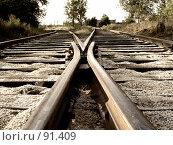 Купить «Скрещивающиеся рельсы, уходящие к горизонту», фото № 91409, снято 23 августа 2007 г. (c) Квитченко Лев / Фотобанк Лори