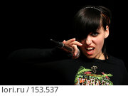 Купить «Девушка с микрофоном в руках на черном фоне», фото № 153537, снято 4 мая 2007 г. (c) Александр Паррус / Фотобанк Лори