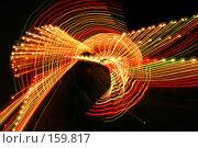 Купить «Праздничная ночная иллюминация на качели в парке аттракционов. Следы разноцветных ламп на движущейся гондоле», фото № 159817, снято 11 июня 2005 г. (c) Harry / Фотобанк Лори