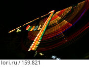 Купить «Праздничная ночная иллюминация на качели в парке аттракционов. Следы разноцветных ламп на движущейся гондоле», фото № 159821, снято 11 июня 2005 г. (c) Harry / Фотобанк Лори