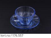 Купить «Чайные блюдце и чашка из прозрачного голубого стекла на тёмном фоне», фото № 176557, снято 15 января 2008 г. (c) Андрей Водилин / Фотобанк Лори