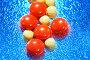 Красные и желтые таблетки на голубом фоне, фото № 179797, снято 26 декабря 2007 г. (c) Astroid / Фотобанк Лори