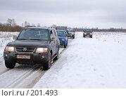 Купить «Внедорожники на зимней дороге», фото № 201493, снято 9 февраля 2008 г. (c) Сергей Лаврентьев / Фотобанк Лори