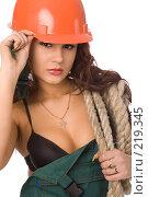 Купить «Сексуальная девушка в строительной каске», фото № 219345, снято 17 февраля 2008 г. (c) Валентин Мосичев / Фотобанк Лори