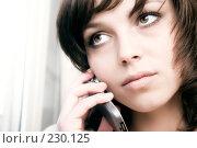 Купить «Девушка разговаривает по мобильному телефону», фото № 230125, снято 1 марта 2008 г. (c) chaoss / Фотобанк Лори