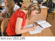 Купить «Девушка пишет в тетрадь.Мгновение из жизни старшеклассников», фото № 263245, снято 26 апреля 2008 г. (c) Федор Королевский / Фотобанк Лори