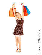 Купить «Девушка с покупками», фото № 265065, снято 6 марта 2008 г. (c) Андрей Армягов / Фотобанк Лори