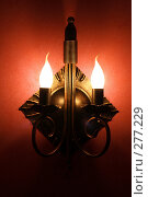 Купить «Металлическая лампа со свечами на красной стене», фото № 277229, снято 5 мая 2008 г. (c) Сницарь Александр / Фотобанк Лори