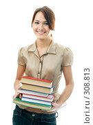 Купить «Девушка с книгами», фото № 308813, снято 16 февраля 2008 г. (c) Анатолий Типляшин / Фотобанк Лори