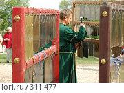 Купить «Инструмент, имитирующий колокольный звон», фото № 311477, снято 10 мая 2008 г. (c) Абдурагимова Наталия / Фотобанк Лори