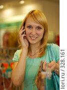 Купить «Молодая девушка говорит по сотовому телефону в магазине женской одежды», фото № 328161, снято 18 июня 2008 г. (c) BestPhotoStudio / Фотобанк Лори