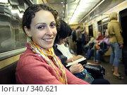 Купить «Девушка в вагоне метро», фото № 340621, снято 21 октября 2018 г. (c) Losevsky Pavel / Фотобанк Лори