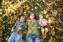 Мама с детьми лежит на траве, фото № 351061, снято 9 августа 2017 г. (c) Losevsky Pavel / Фотобанк Лори