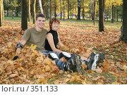 Купить «Роллеры сидят на траве», фото № 351133, снято 30 сентября 2007 г. (c) Losevsky Pavel / Фотобанк Лори