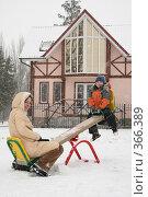 Купить «Мама и сын качаются на качелях. Зима.», фото № 366389, снято 24 октября 2018 г. (c) Losevsky Pavel / Фотобанк Лори