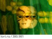 Купить «Абстрактная композиция с масками на зелёном фоне», фото № 380981, снято 31 июля 2008 г. (c) Татьяна Заварина / Фотобанк Лори