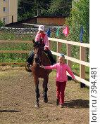 Купить «Одна девочка катает другую верхом на лошади», фото № 394481, снято 9 августа 2008 г. (c) Кардаполова Наталья / Фотобанк Лори