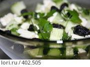 Купить «Салат с огурцом и брынзой крупным планом», фото № 402505, снято 21 июня 2008 г. (c) Svetlana Bachkala / Фотобанк Лори