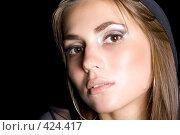 Купить «Портрет красивой молодой девушки на черном фоне изолированно», фото № 424417, снято 26 июня 2008 г. (c) Сергей Сухоруков / Фотобанк Лори