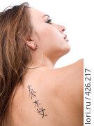 Купить «Татуировка на спине молодой женщины», фото № 426217, снято 2 июля 2008 г. (c) Сергей Сухоруков / Фотобанк Лори
