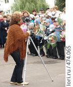 Купить «Фотограф на линейке», фото № 474065, снято 1 сентября 2008 г. (c) Ольга Романенко / Фотобанк Лори