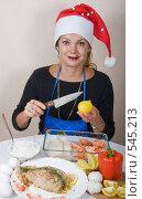 Купить «Готовим кальмары к новогоднему столу», фото № 545213, снято 3 ноября 2008 г. (c) Ольга Кедрова / Фотобанк Лори