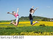Купить «Радостные девочки прыгают в цветущем поле», фото № 549601, снято 9 мая 2008 г. (c) Ирина Игумнова / Фотобанк Лори