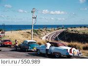 Купить «Старинные автомобили на дороге вдоль океана. Куба», эксклюзивное фото № 550989, снято 26 мая 2020 г. (c) Free Wind / Фотобанк Лори