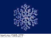 Купить «Снежинка полупрозрачная на синем фоне, изолировано», фото № 585277, снято 22 ноября 2008 г. (c) Архипова Мария / Фотобанк Лори