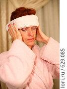 Купить «Женщина, страдающая головной болью», фото № 629085, снято 16 сентября 2008 г. (c) Vdovina Elena / Фотобанк Лори