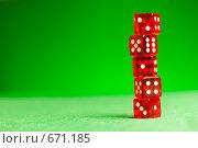 Купить «Красные кубики- кости  на зеленом сукне», фото № 671185, снято 21 января 2009 г. (c) Андрей Армягов / Фотобанк Лори