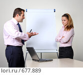 Купить «Коллеги: молодые бизнесмены в офисе готовят презентацию», фото № 677889, снято 21 июля 2007 г. (c) Владимир Мельник / Фотобанк Лори