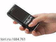 Мобильный телефон в руке. Стоковое фото, фотограф Андрей Чмелёв / Фотобанк Лори