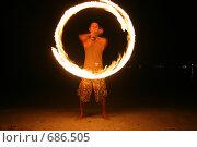 Купить «Мужчина исполняет фаер шоу (огненный танец) ночью на пляже», фото № 686505, снято 4 сентября 2008 г. (c) Алексей Корсаков / Фотобанк Лори