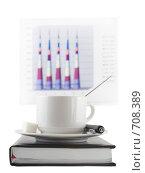 Купить «Закрытый ежедневник,чашка кофе и экономический  цветной  график на заднем фоне», фото № 708389, снято 11 января 2009 г. (c) Vitas / Фотобанк Лори