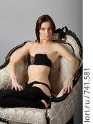 Портрет девушки, сидящей в кресле. Стоковое фото, фотограф Пакалин Сергей / Фотобанк Лори
