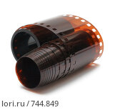 Купить «Скрученная фотопленка», фото № 744849, снято 11 марта 2009 г. (c) Alexandr Shevchenko / Фотобанк Лори