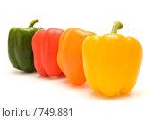 Купить «Четыре разноцветных перца. Изолированный фон», фото № 749881, снято 13 февраля 2009 г. (c) Ирина Доронина / Фотобанк Лори