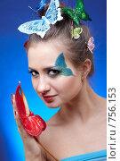 Купить «Девушка с красным цветком», фото № 756153, снято 15 февраля 2009 г. (c) Serg Zastavkin / Фотобанк Лори