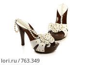 Купить «Женские туфли на высоком каблуке, на белом фоне», фото № 763349, снято 29 июня 2008 г. (c) Александр Паррус / Фотобанк Лори