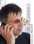 Купить «Мужчина с мобильным телефоном», фото № 766077, снято 31 августа 2008 г. (c) Михаил Лавренов / Фотобанк Лори