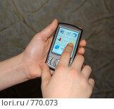 Купить «Рука нажимает на сенсорную панель телефона», фото № 770073, снято 25 марта 2009 г. (c) Елена Азарнова / Фотобанк Лори