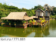 Купить «Дома на сваях. Камбоджа», фото № 771881, снято 9 декабря 2008 г. (c) Татьяна Белова / Фотобанк Лори