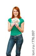 Купить «Девушка с веером из сторублевых купюр», фото № 776097, снято 22 марта 2009 г. (c) Ирина Солошенко / Фотобанк Лори