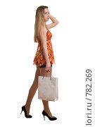Купить «Девушка с покупками», фото № 782269, снято 29 марта 2009 г. (c) Виктория Кириллова / Фотобанк Лори